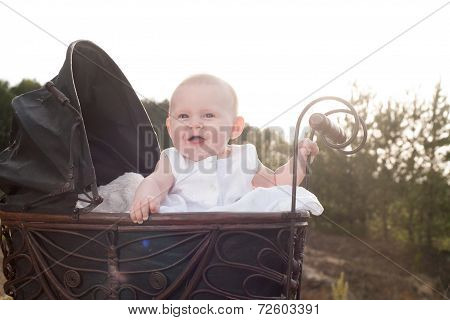 Happy Baby In Her Pram