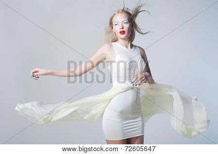 Sexy woman in fluttering white dress