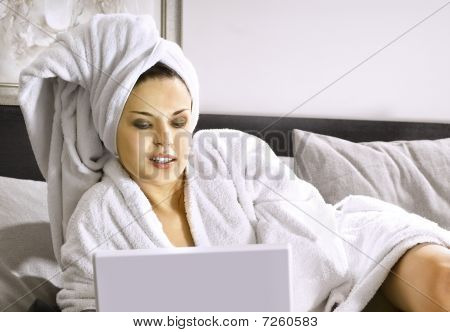 Lady With Laptop On Bed