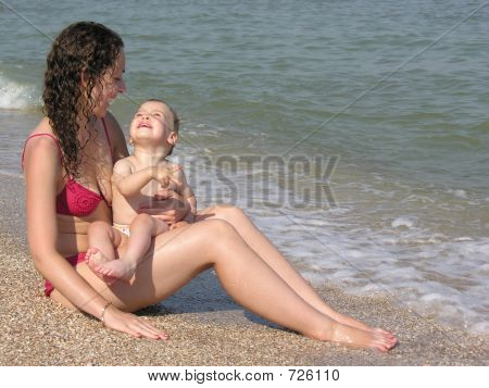 mother with baby on beach