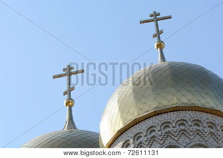 Golden Cupola And Christian Cross On Church Against Blue Sky