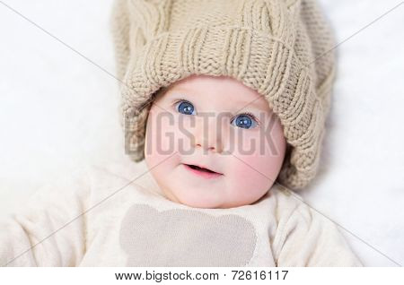 Adorable Newborn Baby Wearing Big Knitted Hat And Sweater