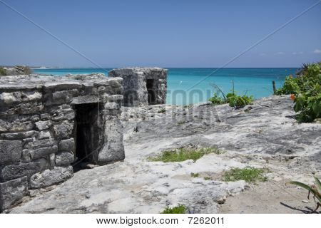 Ancient Mayan Ruin Perched On A Rocky Shoreline