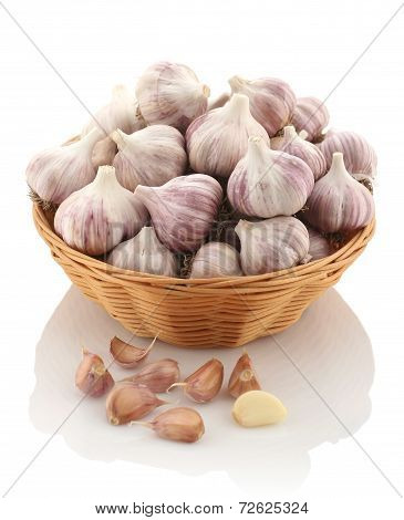 Garlic In A Wicker Basket On A White Background