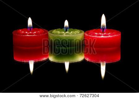 Three candles, reflected