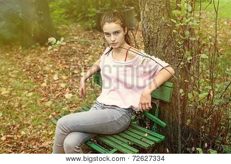 Portrait Of A Strictly Looking Woman Sitting On An Old Bench, Toned Image