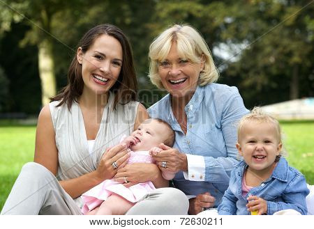 Happy Family With Mother, Children And Grandmother