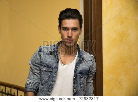 Attractive Young Man Indoors, Leaning Against Door Jamb