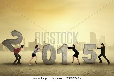 Group Of Businesspeople Arrange Number 2015