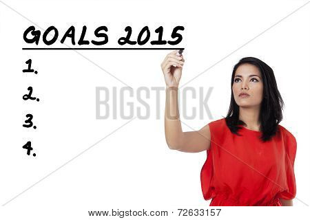 Hispanic Woman Writes Her Goals