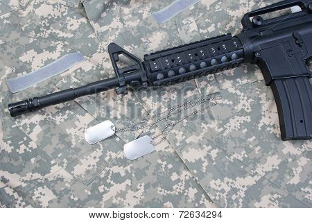 M4A1 Ris Assault Carbine With Blank Dog Tags On Camouflage Uniform