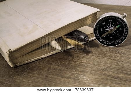 Old book with compass