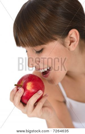 Female Teenager Eat Apple For Breakfast