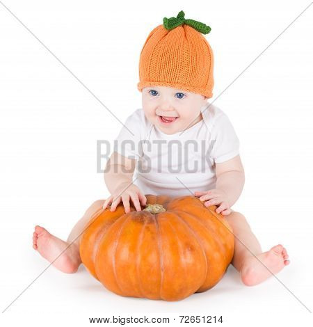Sweet Laughing Baby Girl Playing With Huge Pumpkin Wearing Knitted Pumpkin Hat On White Background
