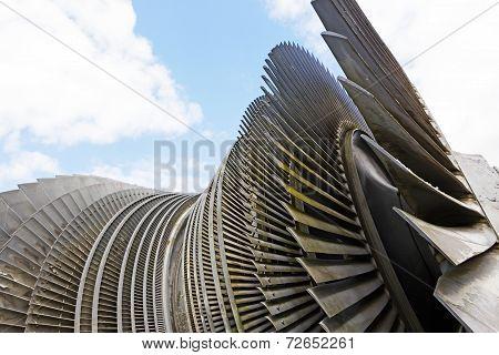 Steam Turbine Of Nuclear Power Plant Against The Sky