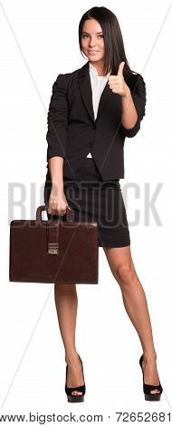 Women hold briefcase and showing thumb-up