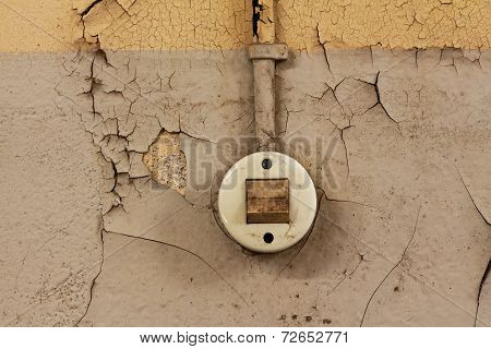 The Old Electrical Switch And Cable On A Decrepit Wall
