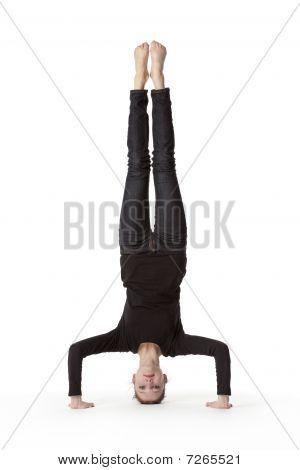Teenage girl in headstand