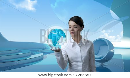 Attractive Brunette Holding Future Globe