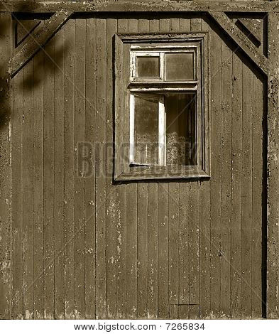 a Window of a the wooden cottage. sepia