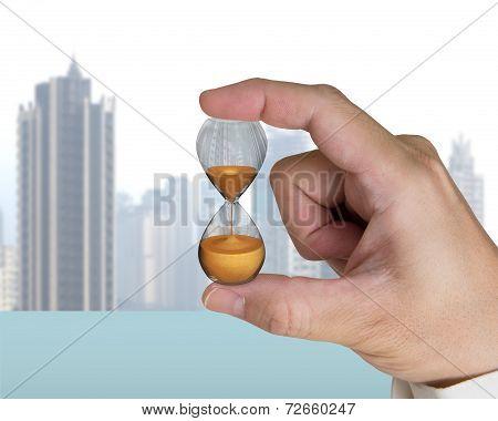 Human Hand Holding Hourglass