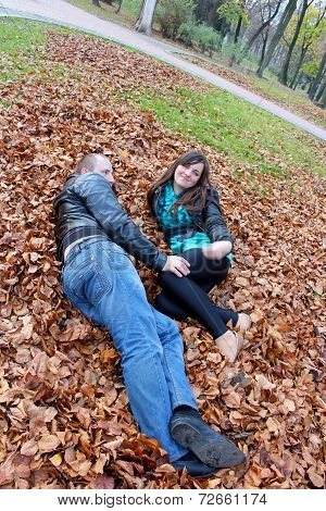 Girl And Guy On The Leaves