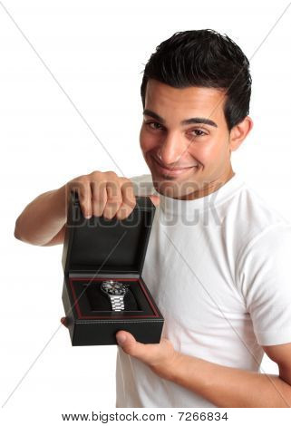 Man Or Salesman Advertising A Wristwatch