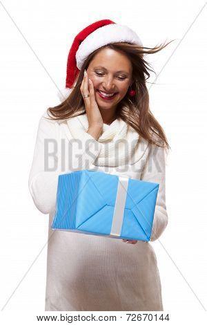 Beautiful Vivacious Woman With A Christmas Gift