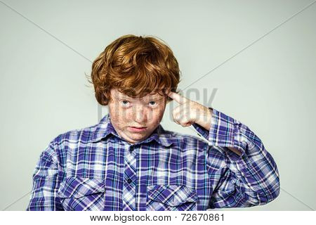 Emotional Portrait Of Red-haired Boy