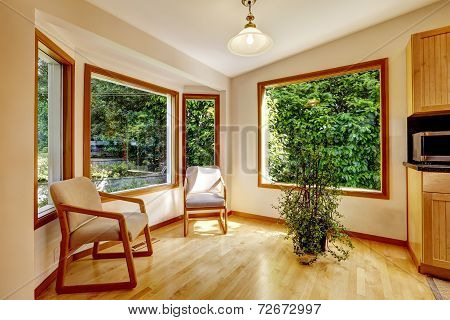 Sunroom Interior With Two Chairs