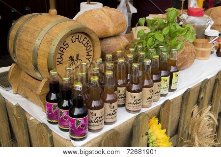 Kvass in cask and bottles on a market