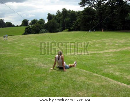 A Beautiful Woman Relaxing On The Grass