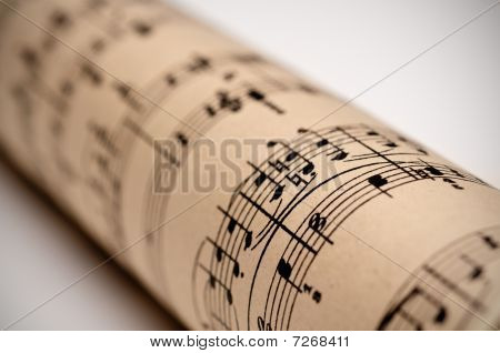 A Roll Of Sheet Music On Old Discolored Parchment