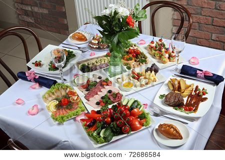 A Table Set With A Variety Of Dishes