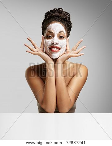 Beauty Black Woman With A Facial Mask Having Fun