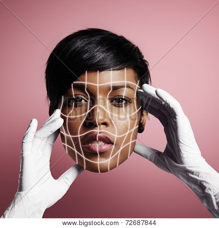 Beauty  Woman's Face In The Hands Of A Doctor