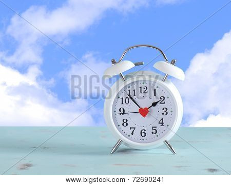 Daylight Savings Time White Clock On A Vintage Aqua Blue Wood Table Against A Sky With Clouds Backgr