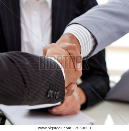 Close-up Of Businessmen Closing A Deal