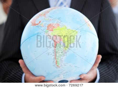 Close-up Of An Executive Holding A Terrestrial Globe