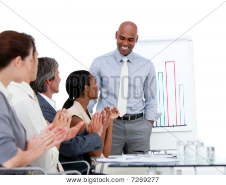 Ethnic Businessman Presenting Statistics In A Company
