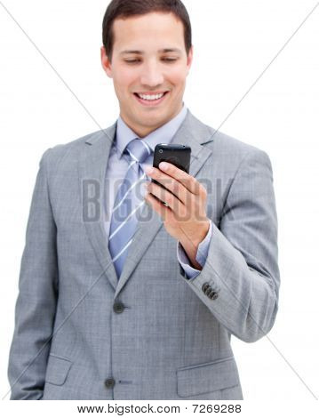 Portrait Of A Victorious Businessman Looking At His Phone