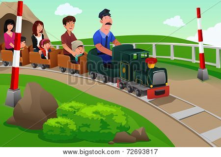 Kids And Their Parents Riding A Small Train