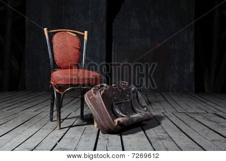 Old Chair And Suitcase