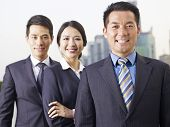 stock photo of rep  - portrait of an asian business team focus on the man in front.