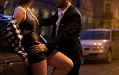 picture of flirt  - Horizontal view of prostitute flirting with businessman - JPG