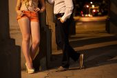 picture of prostitution  - Man talking with prostitute on the street - JPG