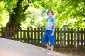 picture of playground school  - Cute School Boy Running On A Playground On A Hot Sunny Autumn Day - JPG