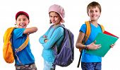 pic of pupils  - Portrait of three smiling pupils of grade school with backpacks and books posing - JPG