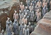 image of qin dynasty  - Terracotta warriors in formation displayed in a burial pit at the Terracotta Army Museum in Xian China - JPG