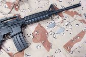 pic of m4  - M4 carbine with blank dog tags on desert camouflage uniform - JPG